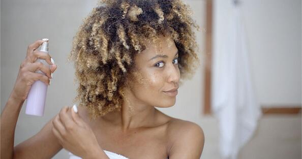 black woman maintaining her hair system with DIY Homemade hair products