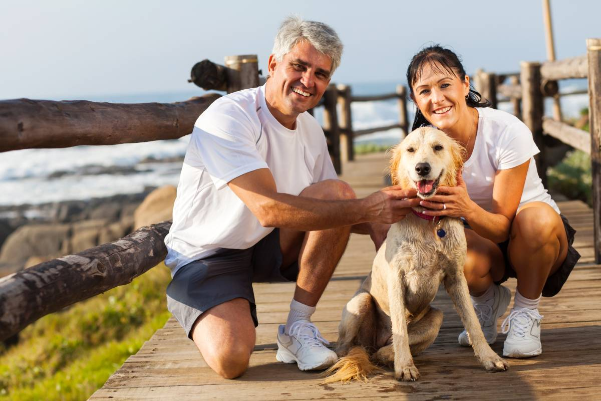 Middle age couple waking thedog and enjoying the life of a Hair System Wearer