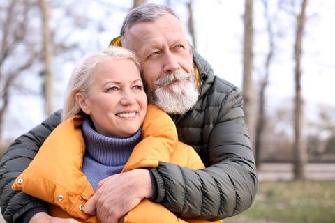 senior couple enjoying outside with their Custom Hair pieces